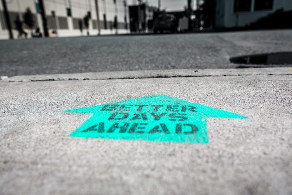 power of positivity - better days ahead painted on concrete